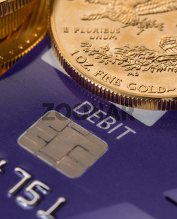 Gold coins on chip and pin debit card
