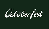 Word Octoberfest on dark green background. Hand-written lettering. Octoberfest holiday concept.