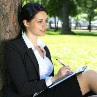 Beautiful businesswoman planning something
