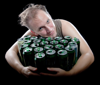 The drunk man and is a lot of empty beer cans