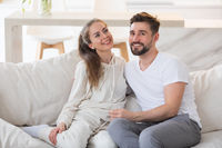 Couple on a sofa at home