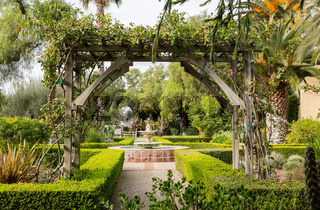 Old traditional garden with pathways and fountain