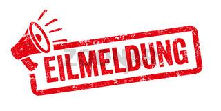 Red stamp with megaphone  - Latest news in german - Eilmeldung