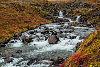 Small waterfalls on the road to Mjoifjordur, Iceland