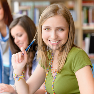 Smiling teenage student girl at study room