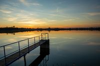 Footbridge on the lake and the view after sunset, Staw, Poland