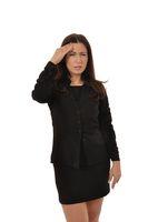Langhaarige Geschaeftsfrau im Miniock hat starke Kopfschmerzen