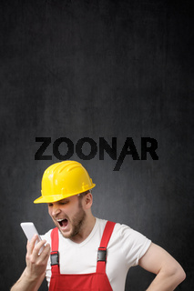 A construction worker shouting on the phone