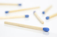 Blue-tipped safety matches on white