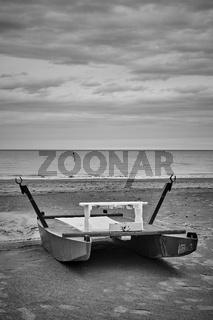 Desolate beach with rescue boat by the sea in Rimini
