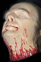 The cut down head. A wax figure separated from a trunk a head of the man