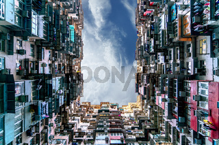 The popular between tourists place called Montane Mansion near to Tai Koo in Hong Kong. Overcrowded old retro building