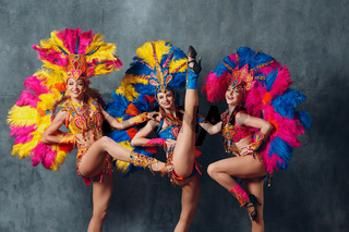 Three Women in cabaret costume with colorful feathers plumage