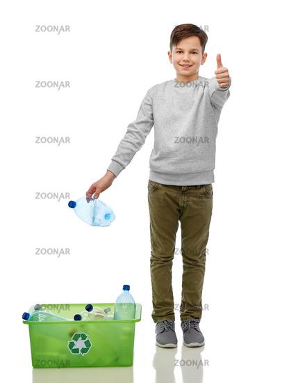 smiling boy sorting plastic waste