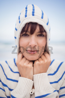 Close up portrait of woman wearing hooded sweater during winter