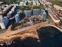 Drone point of view Punta Prima seaside. Spain