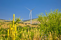 Wind power plant turbines on Velebit mountain region karst