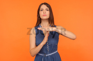 Portrait of young emotional woman on orange background.