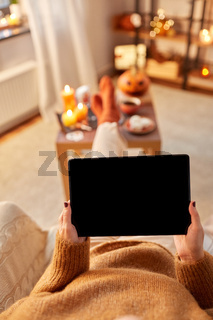 woman with tablet pc at home on halloween