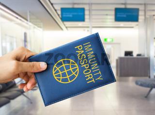 close up of hand holding immunity passport