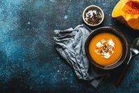 Pumpkin soup in bowl copy space