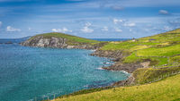 Beautiful coastline with cliffs and turquoise water in Dingle