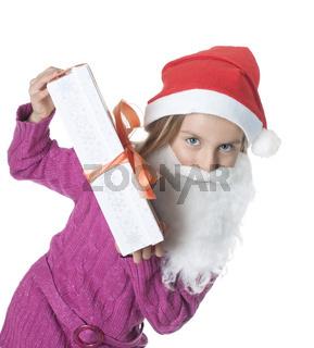 kleines maedchen mit weihnachtsgeschenk