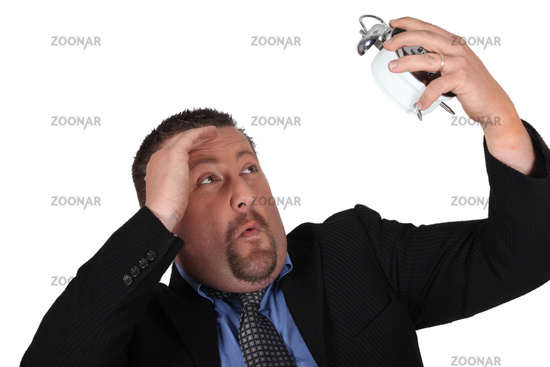 Businessman with an alarm clock