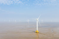wind farm on coastal mudflat wetland