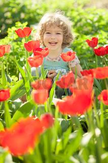 Child in flowery garden