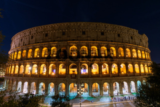 Colosseum at night, an oval amphitheatre and the most popular tourist attraction in Rome, Italy