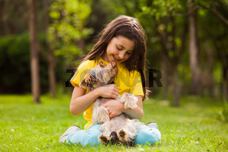 the little girl delighted with the little dog
