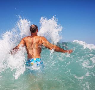 Men in wave