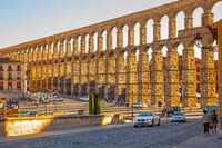 Ancient roman aqueduct in Segovia at sunset