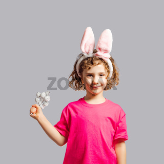 the girl with bunny ears and eggs celebrates Easter