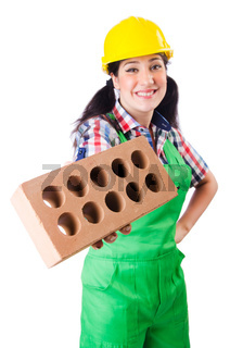 Woman builder with bricks on white