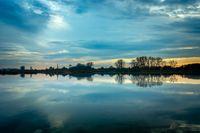 Evening blue clouds over a calm lake