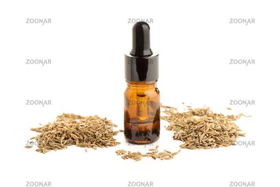 Cumin essential oil bottle isolated on white background. Cuminum cyminum