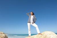 Mature woman fun ocean holiday