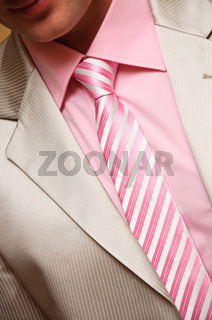 Man's style. suit, shirt and necktie with striped