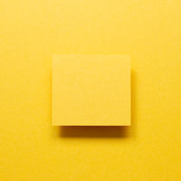 Blank memo paper on yellow background. top view, copy space
