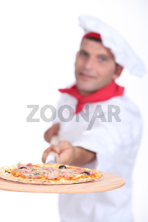 Pizza chef with a wooden board