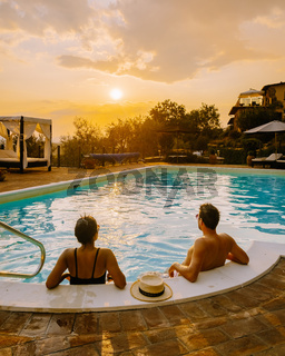 Luxury country house with swimming pool in Italy. Pool and old farm house during sunset central Italy.