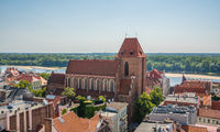 Church of the John the Baptist surrounded by buildings in Torun