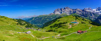 Panoramic landscape of mountains of Alps in summer with green meadow in Portes du Soleil, Switzerland, Europe