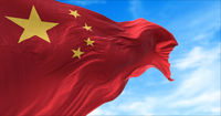 The national flag of China flying in the wind