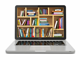 E-learning education or internet library. Laptop and books.