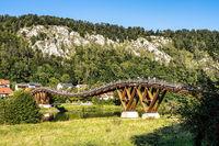 Wooden bridge Tatzelwurm in Essing at Altmuehl river below the ruins of Randeck Castle, Bavaria, Germany