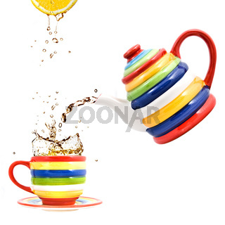 color teapot with cup and lemon isolated on white