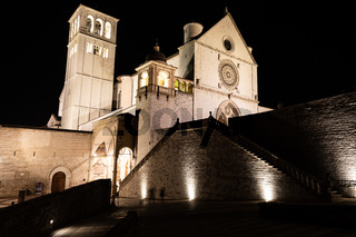Assisi Basilica by night,  Umbria region, Italy. The town is famous for the most important Italian Basilica dedicated to St. Francis - San Francesco.